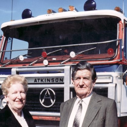 Bill And Heather Norling In Front Of An Atkinson At Their Plant